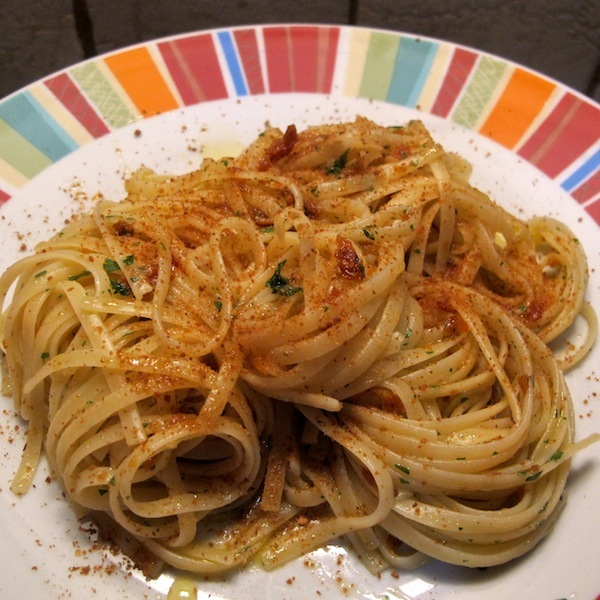 spaghetti carciofi e bottarga completando con la bottarga rimasta e ...